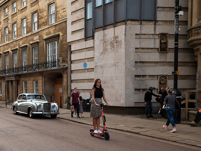Girl on electric scooter in Cambridge City Centre
