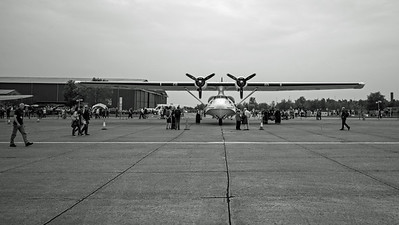 Man walking across a Consolidated PBY-5A Catalina