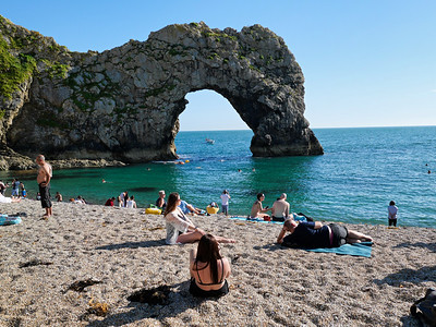Girl is being photographed at Durdle door