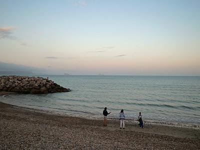 People playing and enjoying at Preston beach, Weymouth, England, UK.