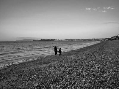 Walk in the Preston beach at sunset. Weymouth, England, UK