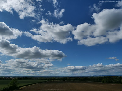 Blue skies, clouds and farms