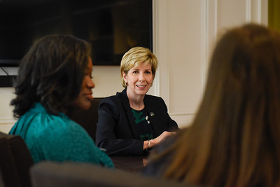 President Cathy Cox meets with the Presidential Transition Committee during her first day as President.