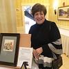 Jane Harmon of Groton with artwork by Lowell artist Bernie Petruzziello