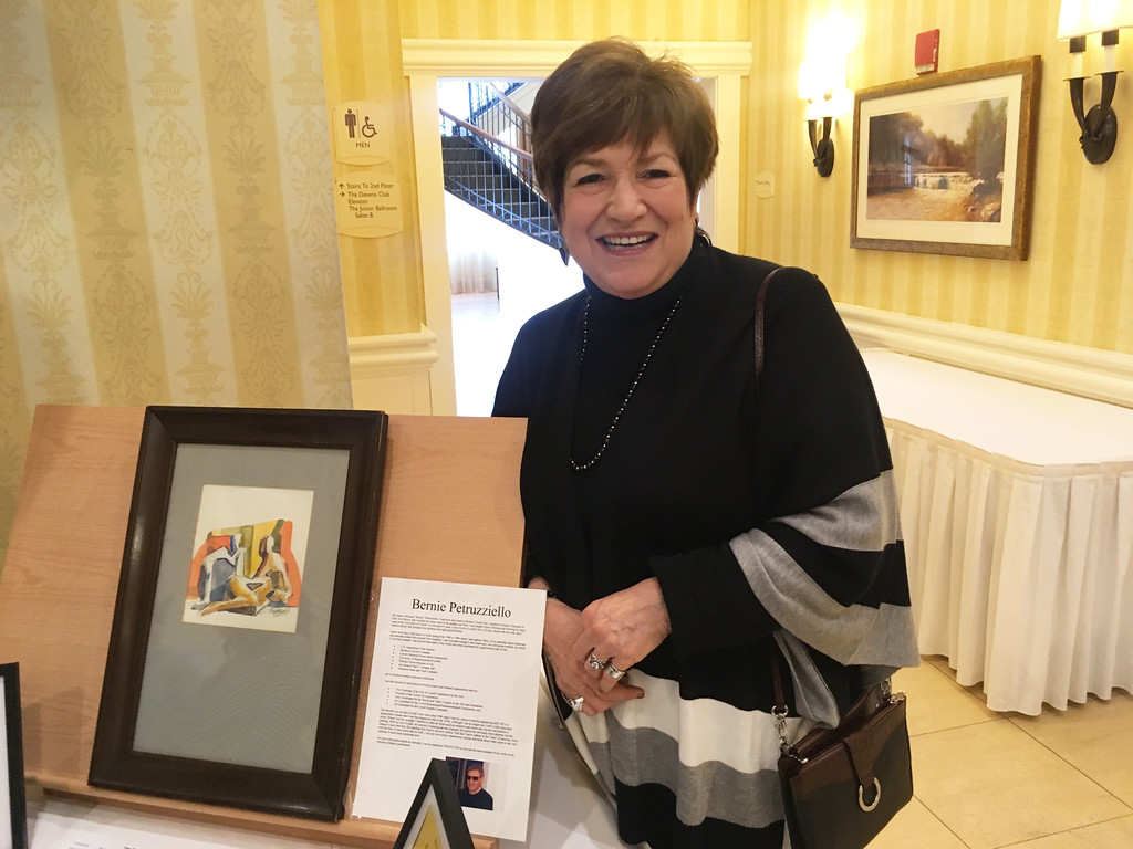 . Jane Harmon of Groton with artwork by Lowell artist Bernie Petruzziello