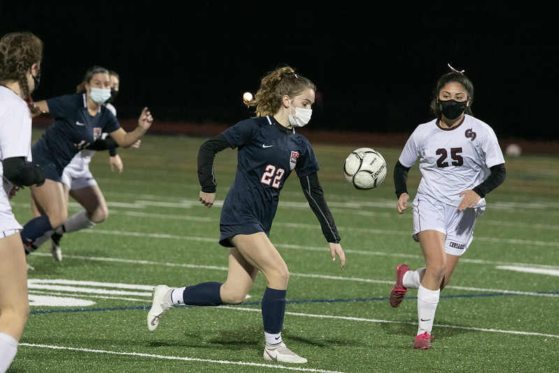 Groton Dunstable Regional High School girls soccer played North Middlesex Regional High School on Tuesday, November 11, 2020 in Townsend. NMRHS's #22 Olivia Robarge takes control of the ball. GD's #25 Cassie Prechtl is in chase to try and stop her. SENTINEL & ENTERPRISE/JOHN LOVE