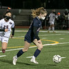 Groton Dunstable Regional High School girls soccer played North Middlesex Regional High School on Tuesday, November 11, 2020 in Townsend. NMRHS's #22 Olivia Robarge takes control of the ball. Just behind her is GD's #25 Cassie Prechtl. SENTINEL & ENTERPRISE/JOHN LOVE