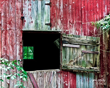 Red Barn Unhinged: This red barn was found on roadside on one of our travels in Pennsylvania.