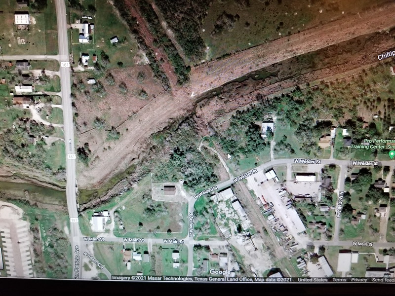 You can see the old railroad tracks crossing the creek. The present road is different now, but you can see the remains of the railroad spur that turns to the left off of West Welder Street