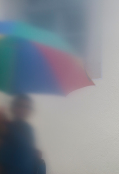 Meissen resident strolls on a rainy afternoon.
