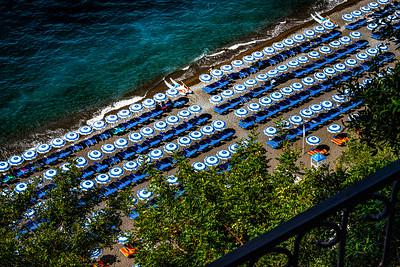 Beach umbrellas dot the beach of Positano.
