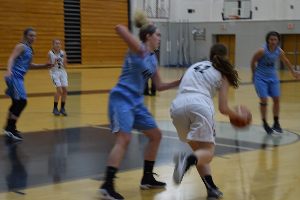. Waterford Mott topped Troy 37-34 in girls basketball action on Tuesday night. (Photo by Paula Pasche)