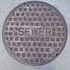 One of four manholes side by side at Franklin Fields in Taft