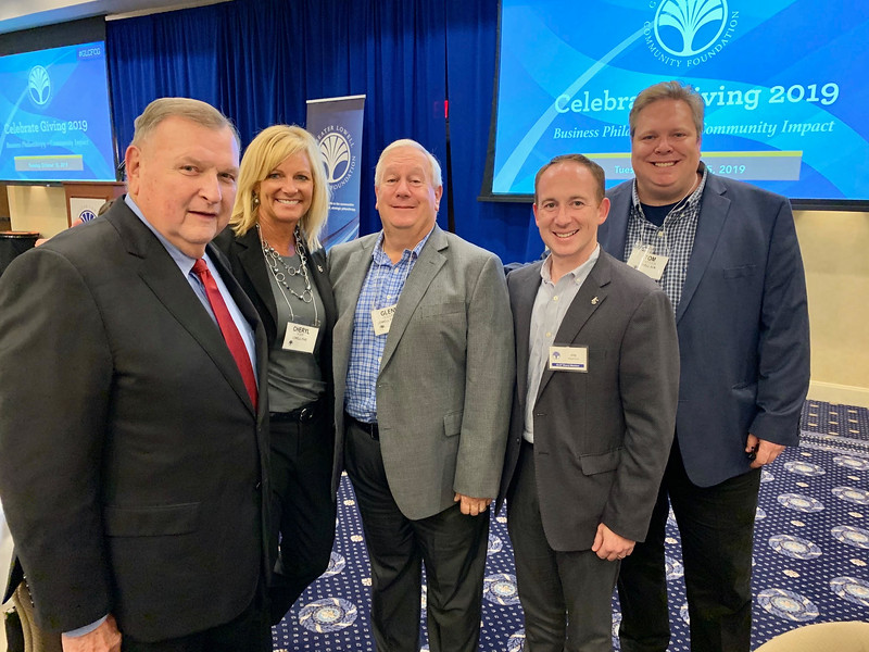 From left, Lowell Sun Charities President Terry McCarthy of Lowell, Lowell Five's Cheryl Popp of Westford, Glenn Goldman of Dracut and Jay Stephens of North Andover, and Sun Editor Tom Shattuck