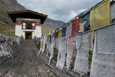 Suspension bridge made from wood and chain across Paro river near Tachog Lhakhang Dzong, Paro, Bhutan