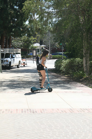 GLORIA THE BIONIC WOMAN ON HER SCOOTER