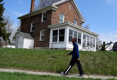 Houses in the General Motors Modern Housing neighborhood in Pontiac, near General Motor's global propulsion systems facility on Glenwood Avenue, on Friday, April 14, 2017.
