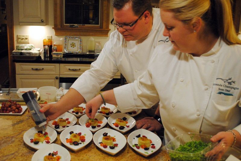 Chefs Justin Dain and Amanda Champagne of PINE Restaurant of the Hanover Inn at Dartmouth preparing the scallop plates.