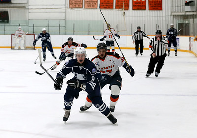 Cody Storm Cooper Photography photo  Players race back to try to beat the icing call.   The Parry Sound Islanders were defeated by the Bracebridge Blues by a score of 4-3 on Sunday night at the Humphrey Community Centre.
