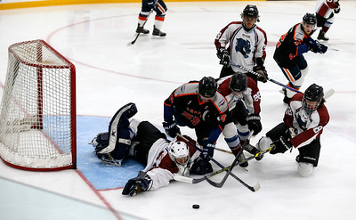 Cody Storm Cooper Photography photo  Players from both teams dive for the puck in front of the Haliburton net.  The Parry Sound Islanders defeated the Haliburton Wolves by a score of 5-4 on Saturday evening at the Humphrey Community Centre.