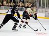 #17 Tim Tarvis manouvers around Huskies defence