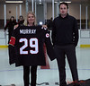 Hockey Canada presents an official Olympic Graeme Murray shirt to the Mayor of the Town of Gravenhurst.