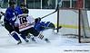#16 Jack Krolak rushes the goal