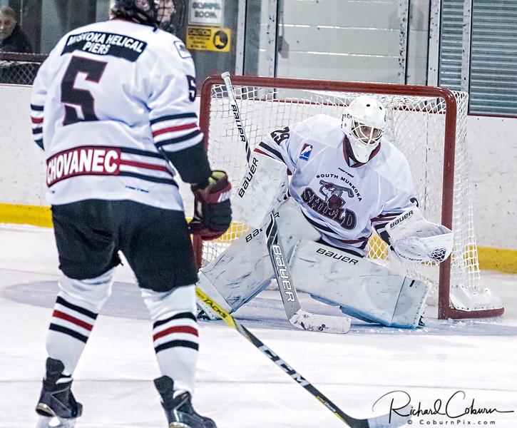 #29 Kamil Paciga gloves the puck
