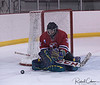 31 SMS Ryan Schirano deflects Home Hardware puck