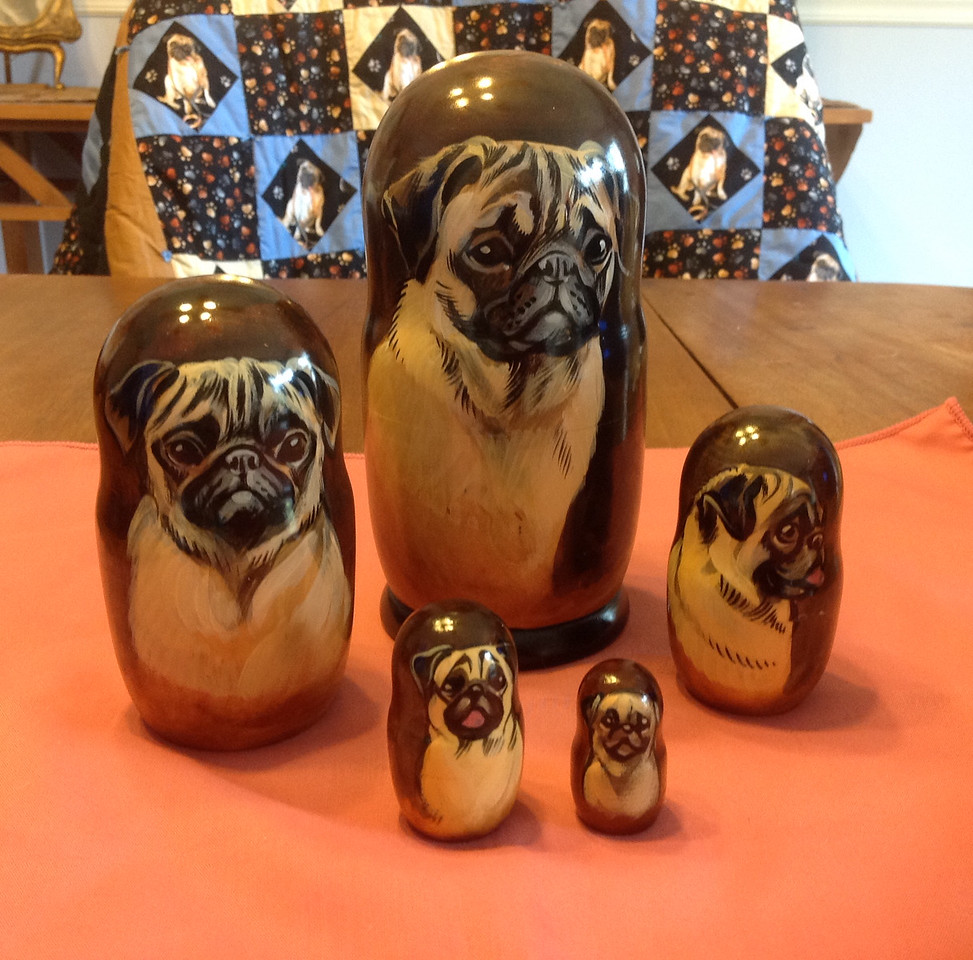 Very unique set of 5 hand painted nesting pug dogs.<br /> <br /> Winner pays shipping<br /> <br /> Starting bid $25