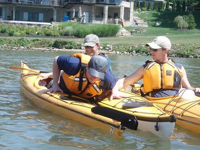 Jim getting back into his kayak.