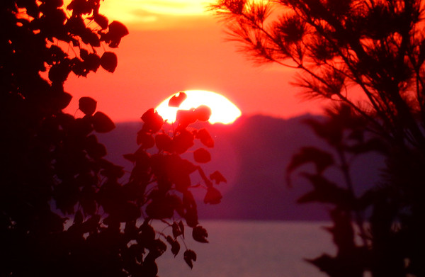 The sun sets over the Leelanau Peninsula, as seen from Bowers Harbor. Photo by Rick Tasch.