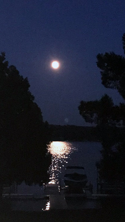 A strawberry moon over Lake Charlevoix. Photo by Woody Brzak.
