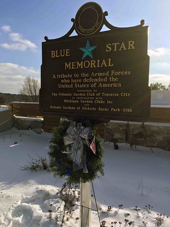 A wreath beneath the Blue Star Memorial at the Botanic Gardens at Historic Barns Park. Photo by Jill Stilt.