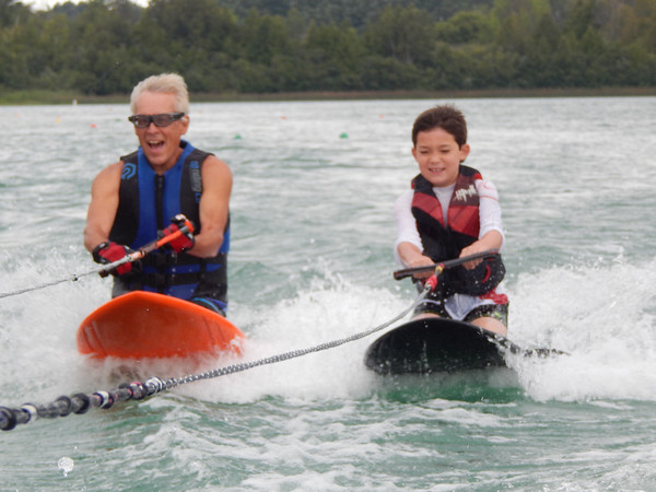 Jerry Swift and grandson, Braedyn, 10, enjoy kneeboarding on Cedar Lake. Photo by Sue Swift.