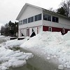April ice damage to the Owl's Nest boathouse on Lake Leelanau. Photo by David Kirby.