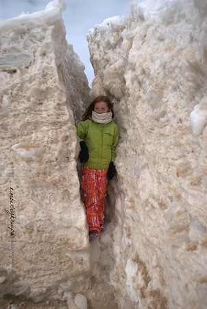 Daughter peeking through the ice cave in Empire in early March this year. Photo by Kim Kroupa.