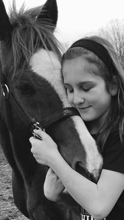 A girl in love with her horse. Photo by Arlene Balesh.