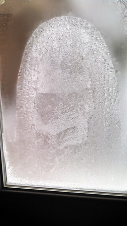 "An icy ""snow squatch"" perches on a garage window. Photo by Alan R. Blair."