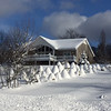 Snow gnomes guarding a summer home in Alden. Photo by Carol Dell.