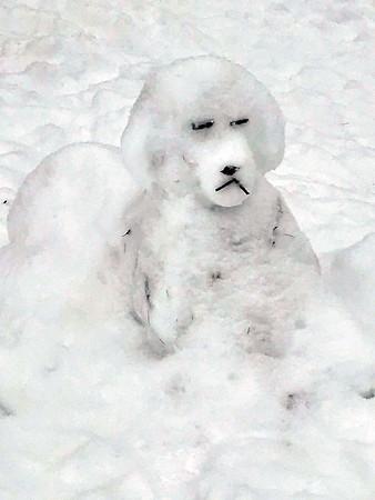 """A Ramsdell Street """"snow dog"""" sculpted by Jillian Somerville, 11. Photo by Karen Schneider."""