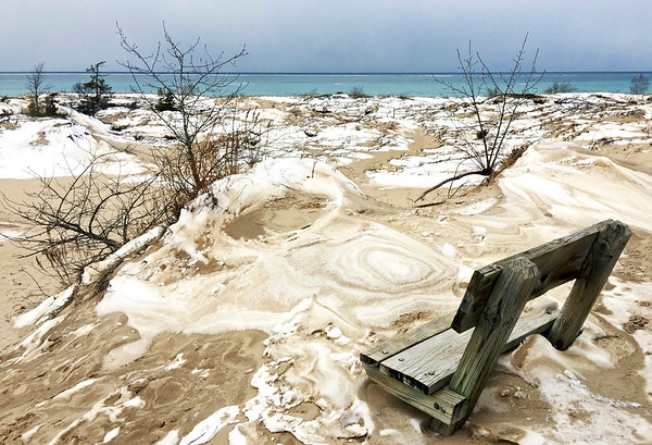 Sand, snow, water and sky meet at Cat Head Bay overlook in Leelanau State Park. Photo by Phil Garrison.