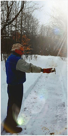 Don't need a bird feeder when we have a friend like Jerry Swift of Interlochen. Photo by Sue Swift.