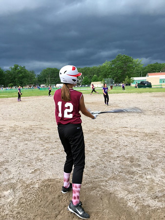 A storm threatens a softball game. Photo by Russ VanHouzen.
