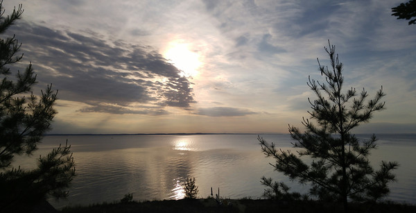 A shimmering sunset over East Bay from Kewadin. Photo by Anne Benington.