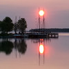 Sunrise captured by the masts of the Inland Seas on Suttons Bay. Photo by Gail Hetler.