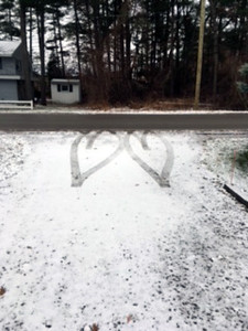 A 'two-heart' impression formed by the tires of a car that pulled into a driveway to turn around. Photo by Angie Glick.