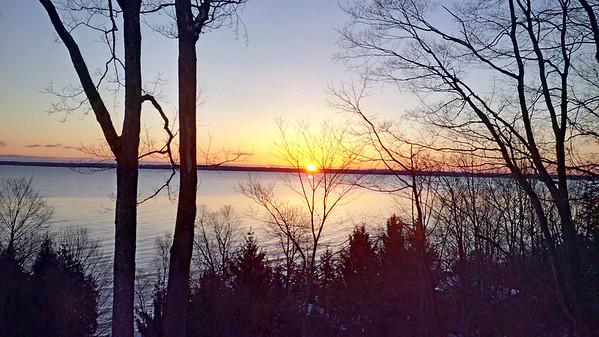 Sunrise over West Bay. Photo by JJ Johnson.