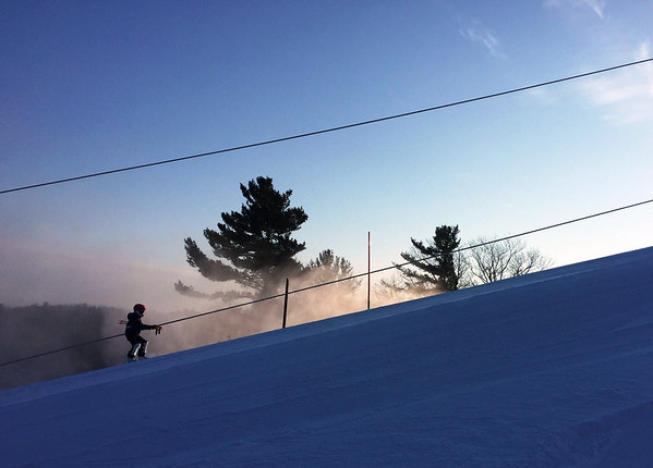 A Mt. Holiday race team skier heads up the hill on an early Saturday morning. Photo by <br /> Rebecca Kalajian.