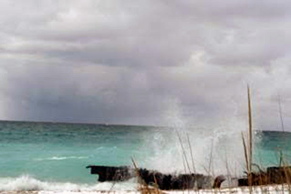 Waves crash at Point Betsie. Photo by Pat Sheafor.